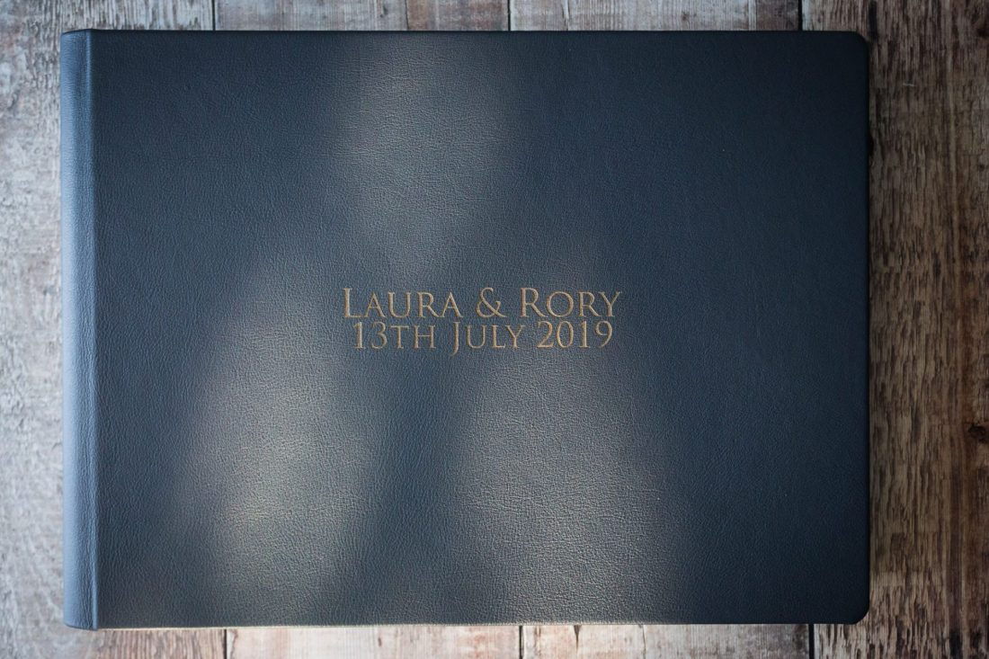 First Light wedding album cover option: distressed leather with laser etching